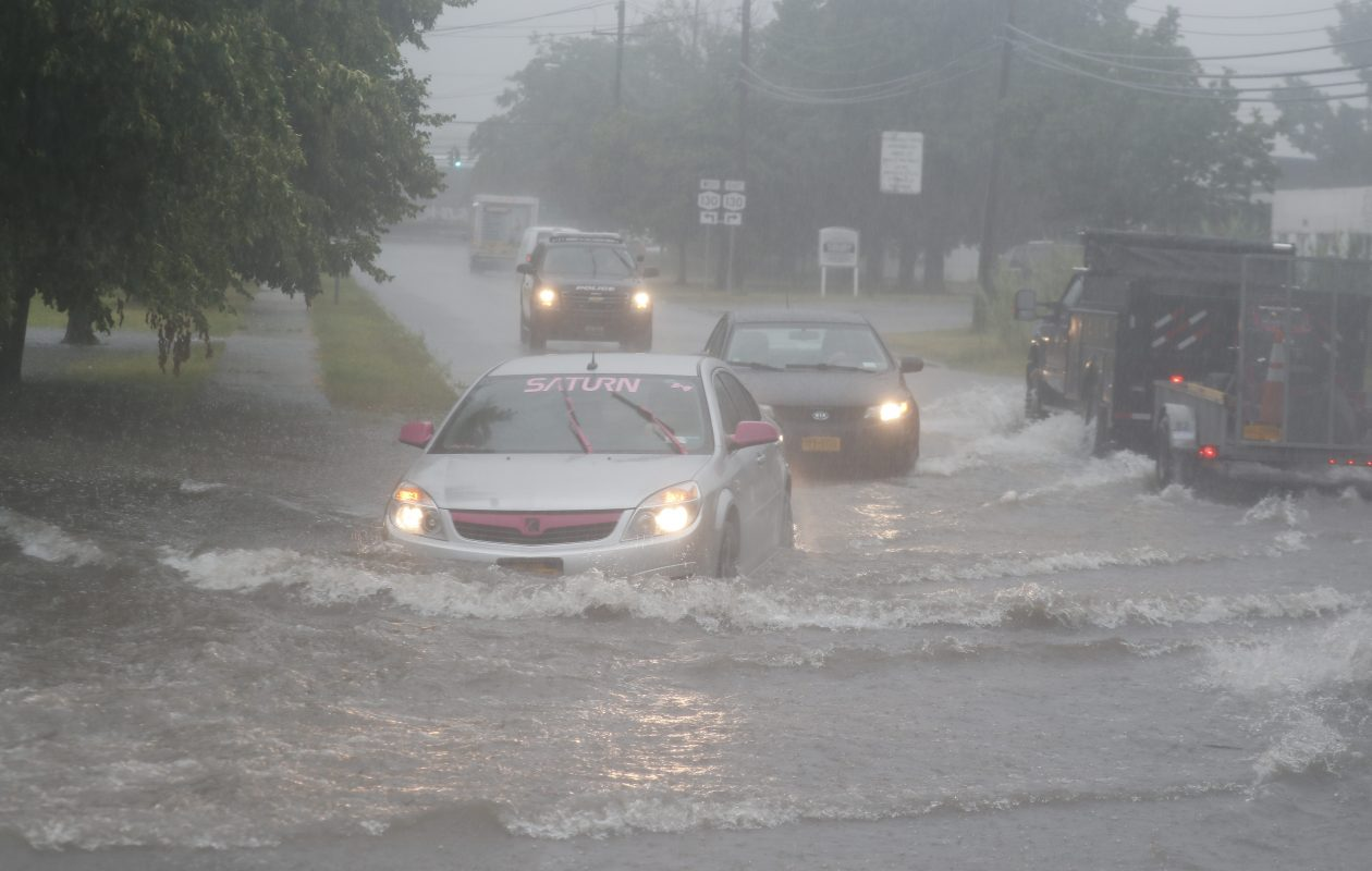 Traffic deals with flooding on access road from Harlem Road to Broadway,  in Cheektowaga, N.Y. on Thursday, July 13, 2017.  (John Hickey/Buffalo News)