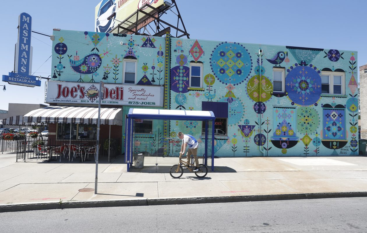 'Magic Buffalo,' a new mural by the Los Angeles-based artist Bunnie Reiss, is on three sides of 1322 Hertel Ave. (John Hickey/Buffalo News)