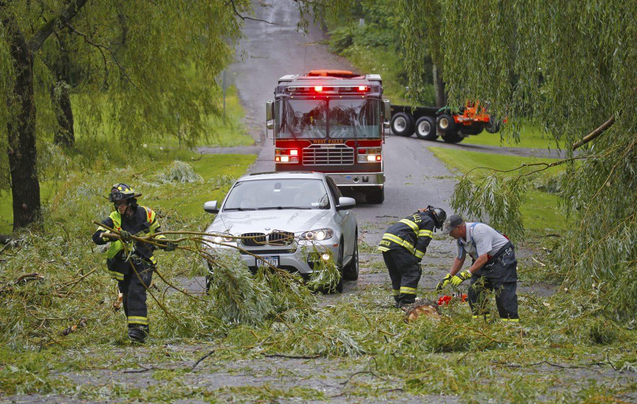 West Falls volunteer fire fighters  work to clear Knapp Road of fallen trees in West Falls on Thursday. (Robert Kirkham/Buffalo News)
