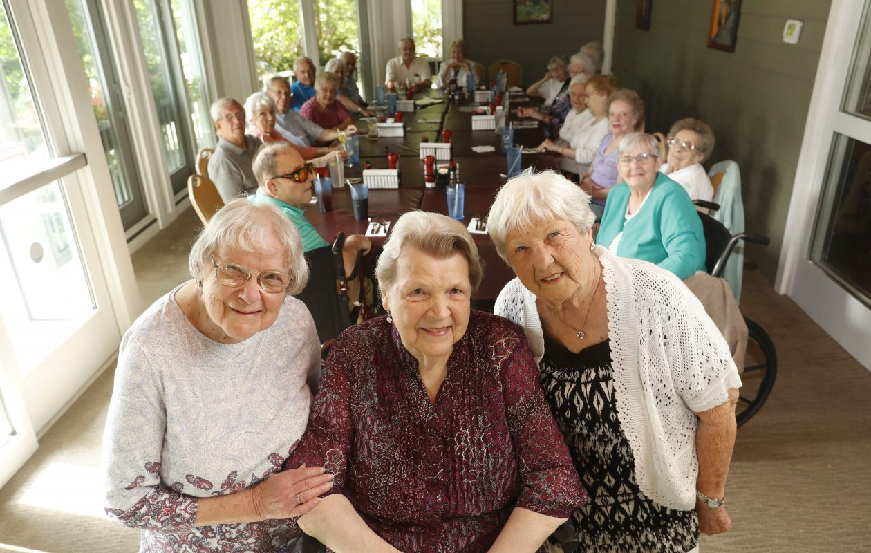 Orchard Park High School Class of 1947 classmates Mary Ann Gravius, left, Myra Ferguson, center, and Shirley Hull, right, celebrate their 70th reunion with other classmates and their spouses during a gathering at JP Fitzgerald's in Hamburg on Sunday, July 23, 2017.            (Mark Mulville/Buffalo News)