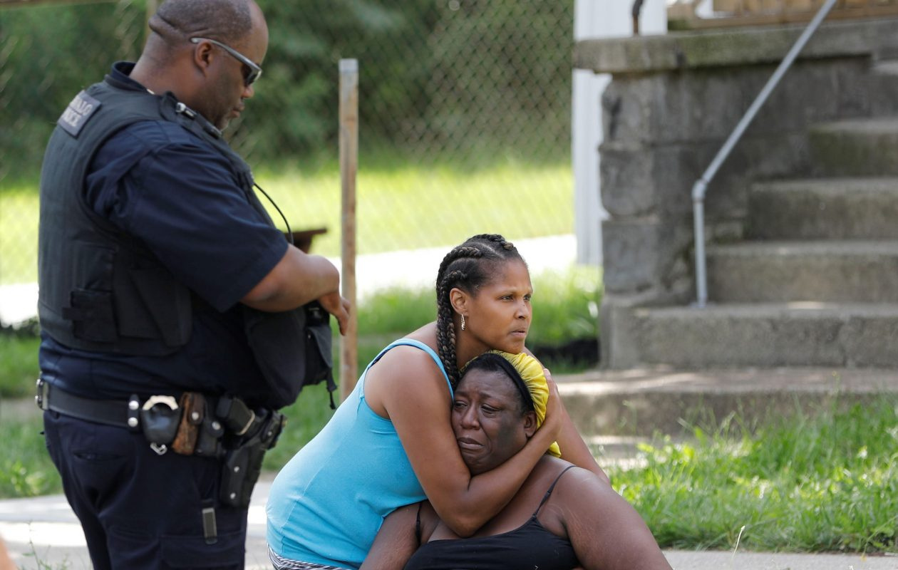 Women identified as family of one of the five victims grieve on Carl Street after learning that a victim had died after a mass shooting, Saturday, July 29, 2017.  (Derek Gee/Buffalo News)