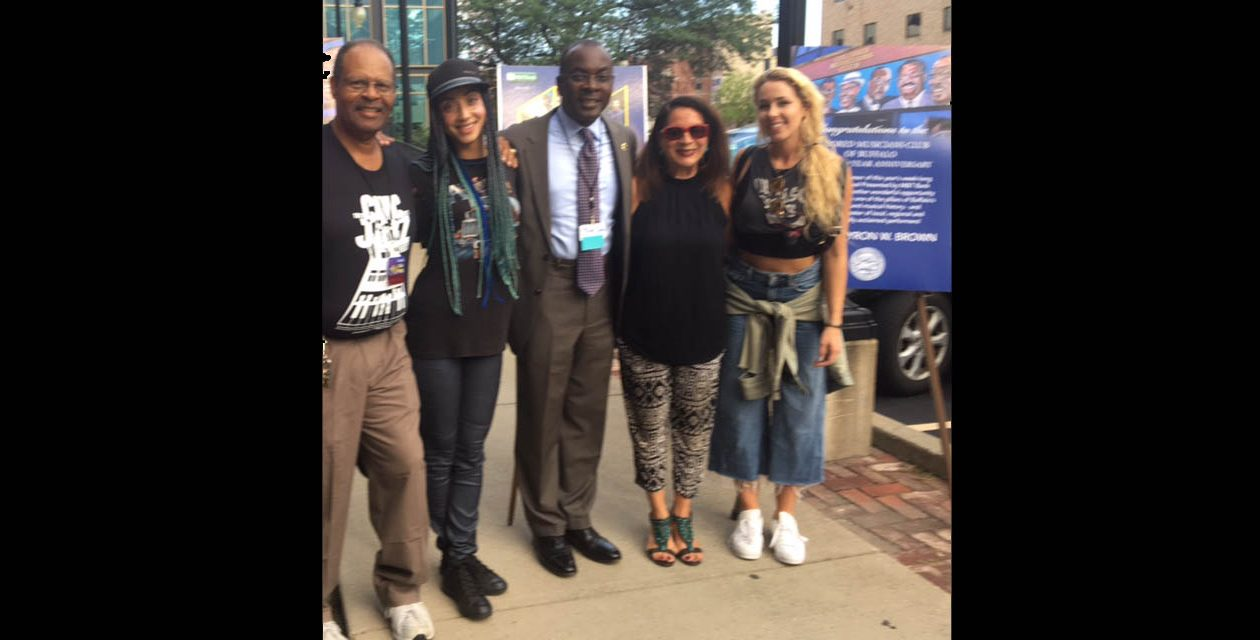 Zuri Appleby (in black cap) and Arianna Powell (on far right) of the music group A2Z will be performing tonight for the Colored Musicians Club's Jazzfest. Also pictured are Mayor Byron Brown and club President George Scott (on far left).