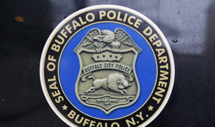 Instead of breaking up street football game, Buffalo police officer joins in
