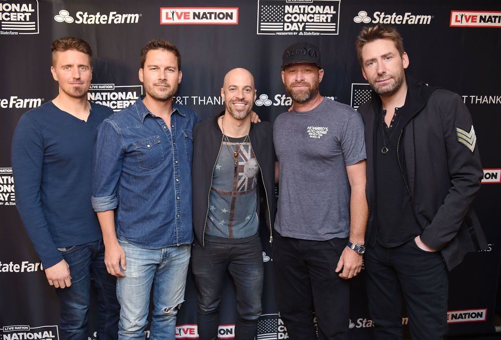 Chris Daughtry of Daughtry, center, joins, from left, Daniel Adair, Ryan Peake, Mike Kroeger and Chad Kroeger of Nickelback at Live Nation's celebration of the third annual National Concert Day at Irving Plaza on May 1, 2017, in New York City.  (Photo by Michael Loccisano/Getty Images for Live Nation)