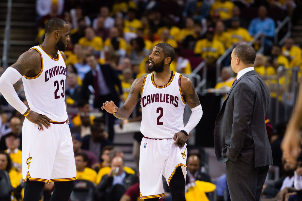 LeBron James, Kyrie Irving and head coach Tyronn Lue of the Cleveland Cavaliers talk during the second half of Game One of the NBA Eastern Conference semifinals against the Toronto Raptors at Quicken Loans Arena on May 1, 2017 in Cleveland, Ohio. (Getty Images)