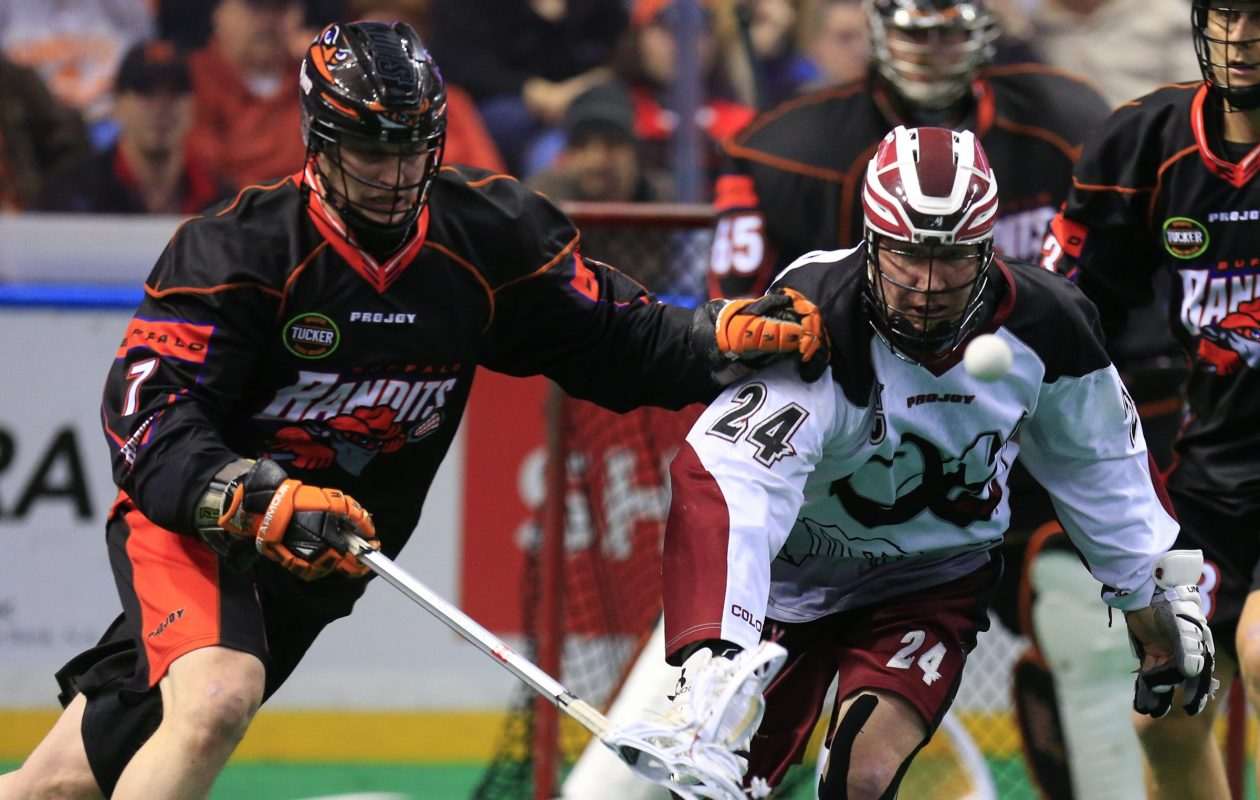 John Grant Jr. (right) retires as one of the greatest players in indoor lacrosse history. (File photo by Harry Scull Jr./Buffalo News)