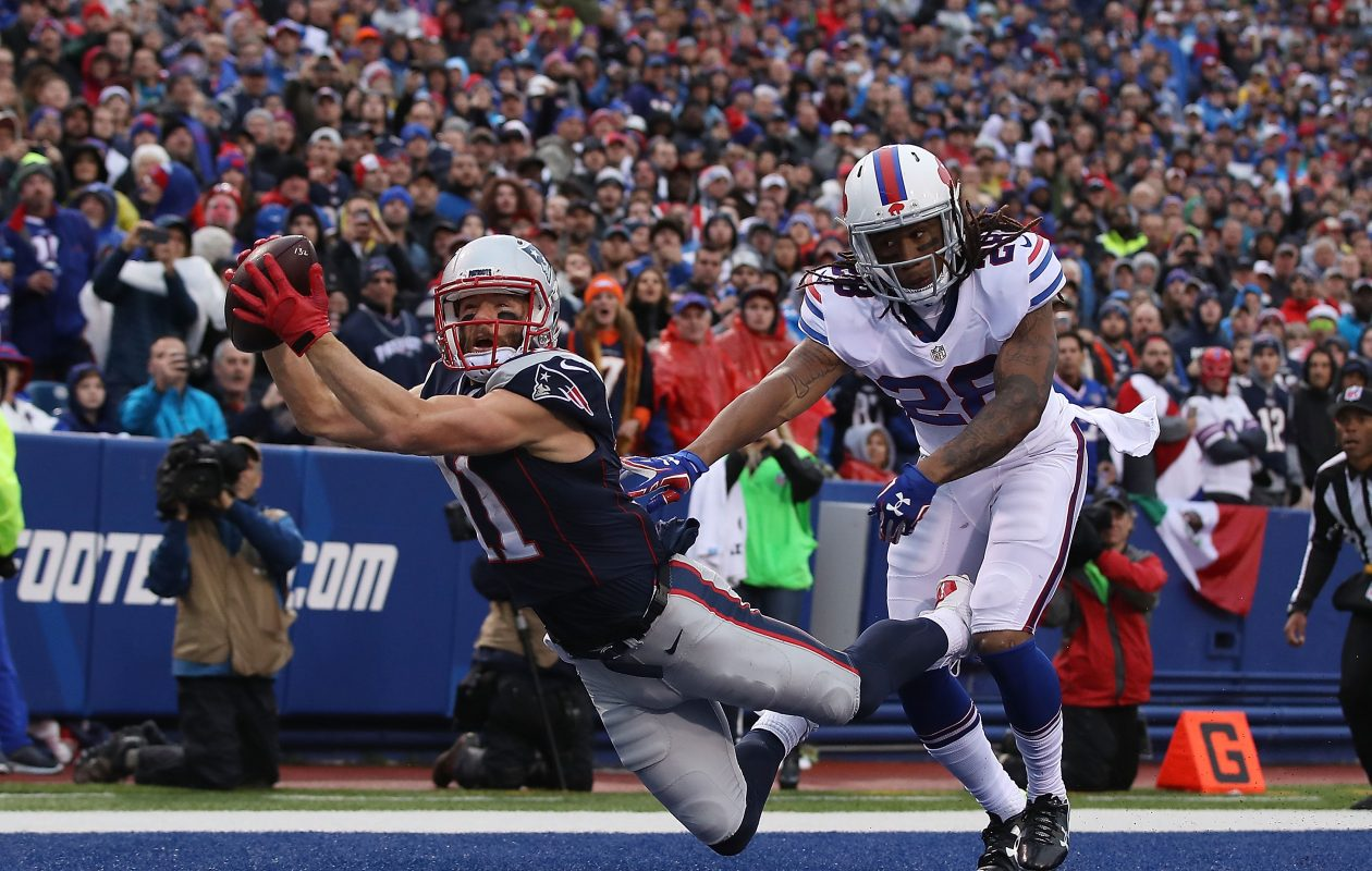 Ronald Darby and the Buffalo Bills don't have great odds of making the playoffs, according to Bovada. The opposite is true for Julian Edelman and the Patriots. (Getty Images)