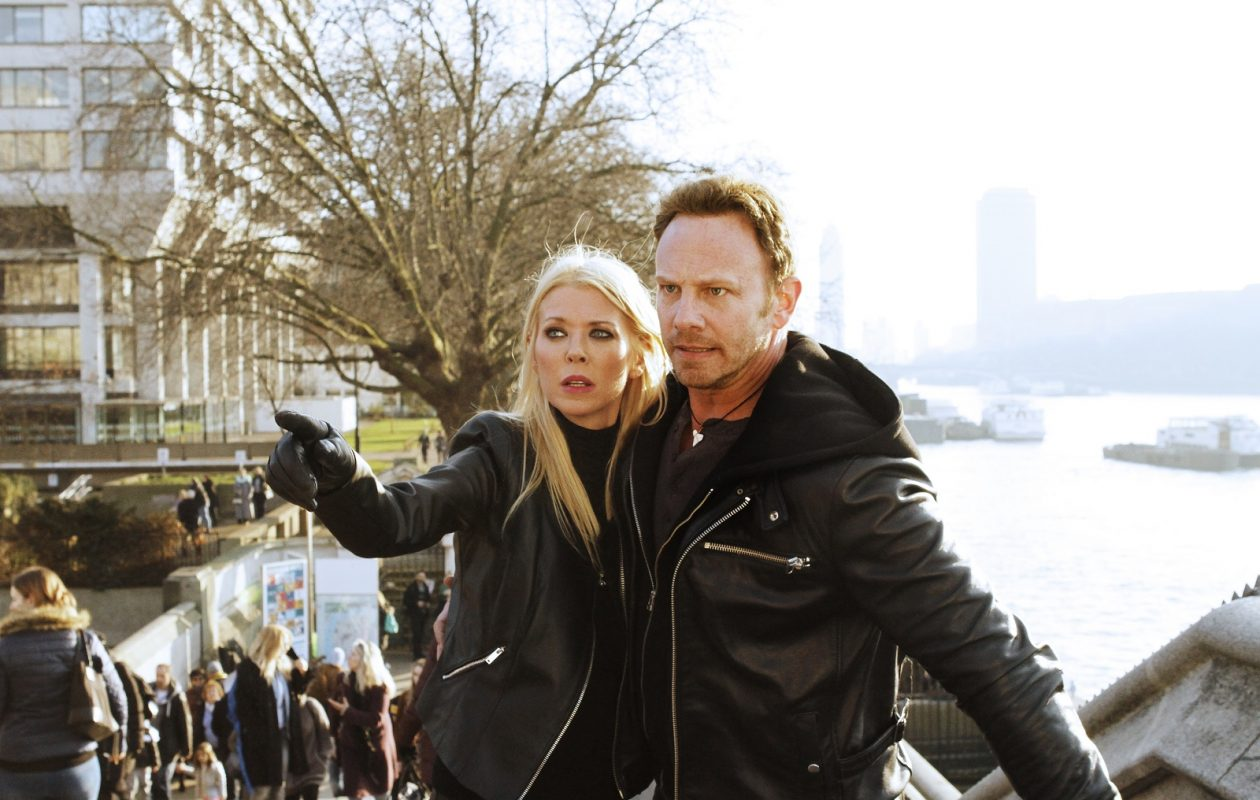 """Tara Reid and Ian Ziering are back to battle the 'Nados in """"Sharknado 5: Global Swarming,"""" premiering Aug. 6 on Syfy. (Photo by: Simon Mein/Syfy)"""