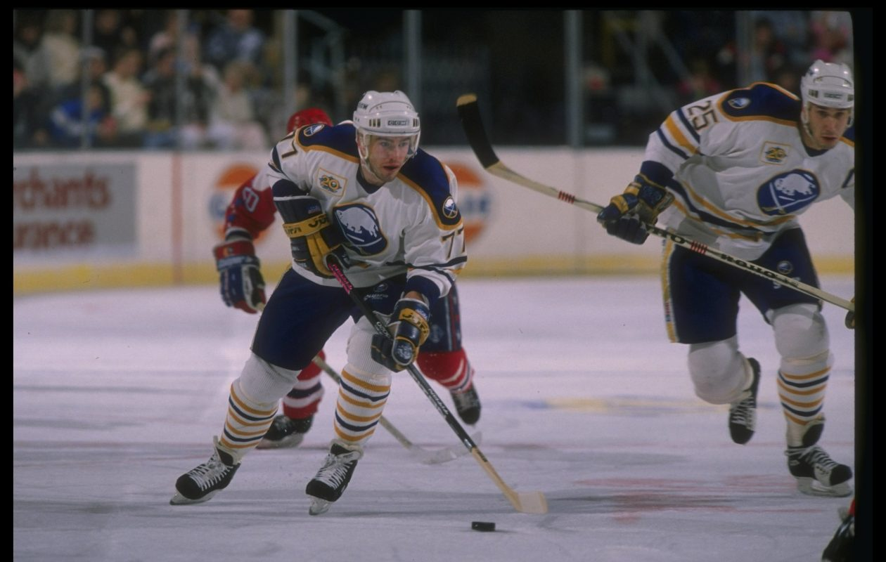 Pierre Turgeon moves the puck up ice with Hall of Famer Dave Andreychuk during a 1989 game in Memorial Auditorium (Rick Stewart  /Allsport).