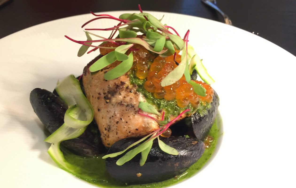 Salmon in green garlic bouillon at Chez Ami. (Andrew Galarneau/Buffalo News)
