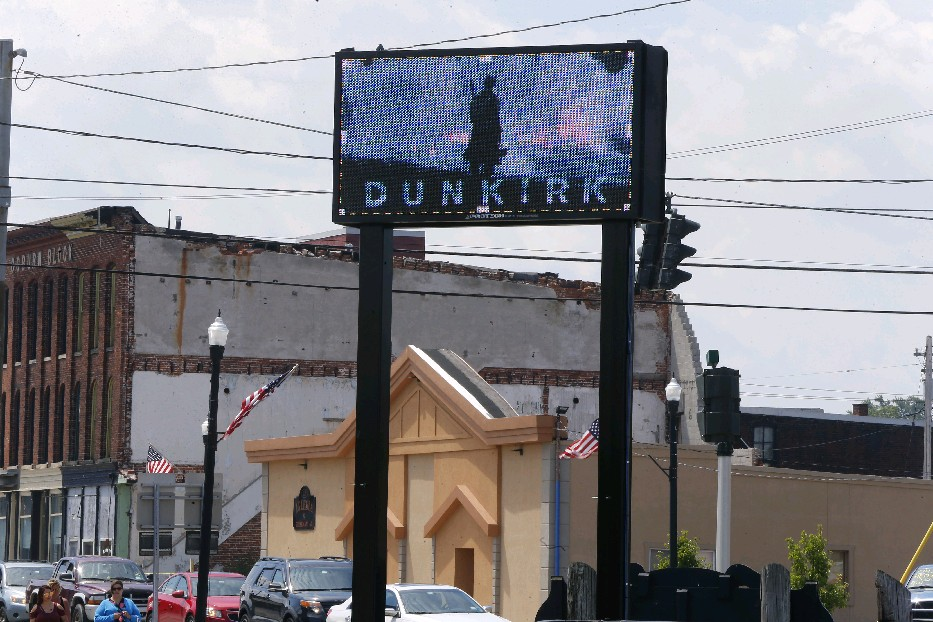 "An advertisement for the film ""Dunkirk"" above the entrance to the harbor at Dunkirk, N.Y., sister city to the French community. (Mark Mulville/Buffalo News)"