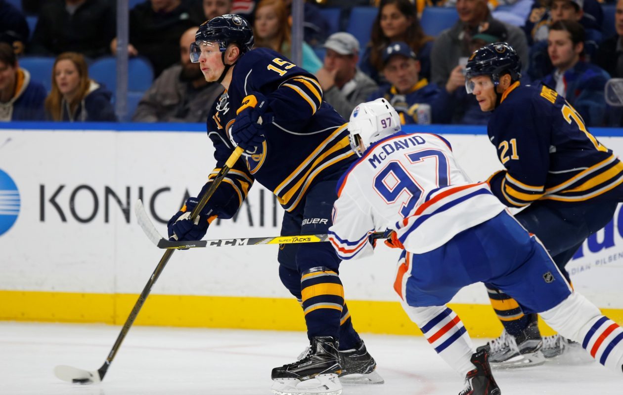Buffalo Sabres Jack EIchel skates past Edmonton Oilers Connor McDavid during third period action at the Key Bank Center on Tuesday, Dec. 6, 2016. (Harry Scull Jr./Buffalo News)