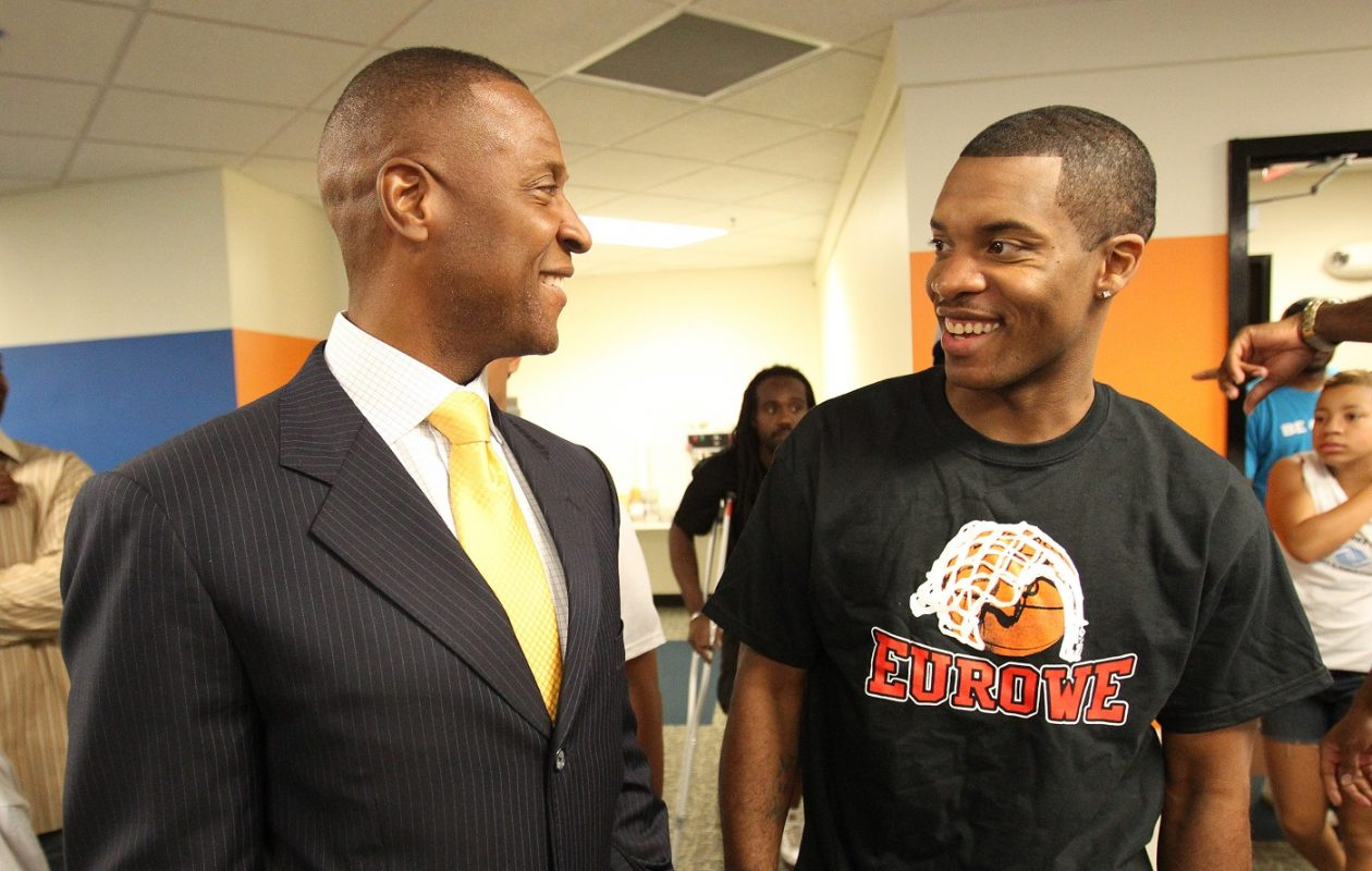 Jason Rowe, right, talks with Curtis Aiken during a get-together in 2011. {James P. McCoy / Buffalo News}