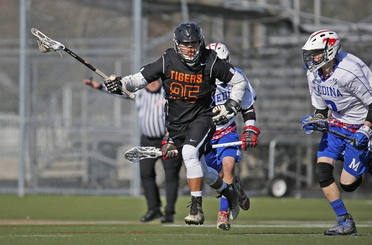 Akron's Owen Hill (25) wins a draw from Medina's Mason Lewis during first half action at Veterans Memorial Park in Medina on Tuesday, April 21, 2015.(Harry Scull Jr./Buffalo News)