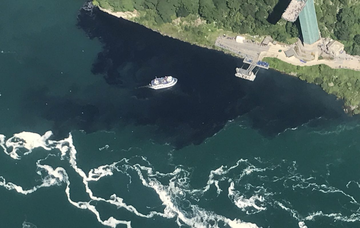 Black discharge from the Niagara Falls Waste Water Treatment Plant engulfed the Maid of the Mist docks on July 29, 2017. (Courtesy of Rainbow Air Inc.)
