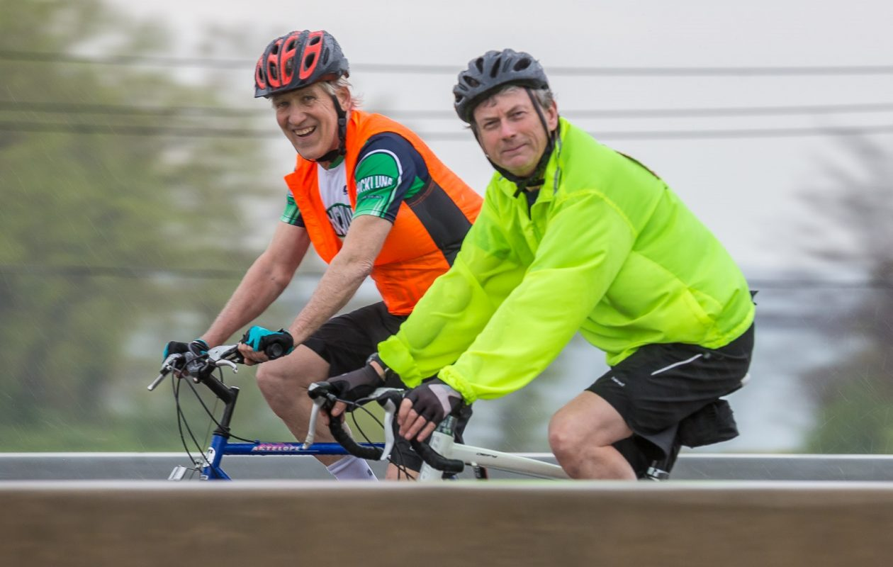 Dr. Bruce Naughton, left, Univera Healthcare chief medical officer for Medicare, and his friend Jim O'Connor participate in a recent Slow Roll Buffalo event.