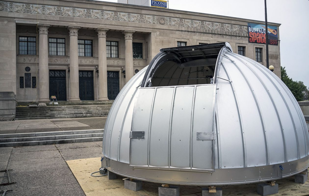 The new aluminum dome of the Kellogg Observatory is ready to be placed into position atop the Buffalo Science Museum on Aug. 11. (Derek Gee/Buffalo News)