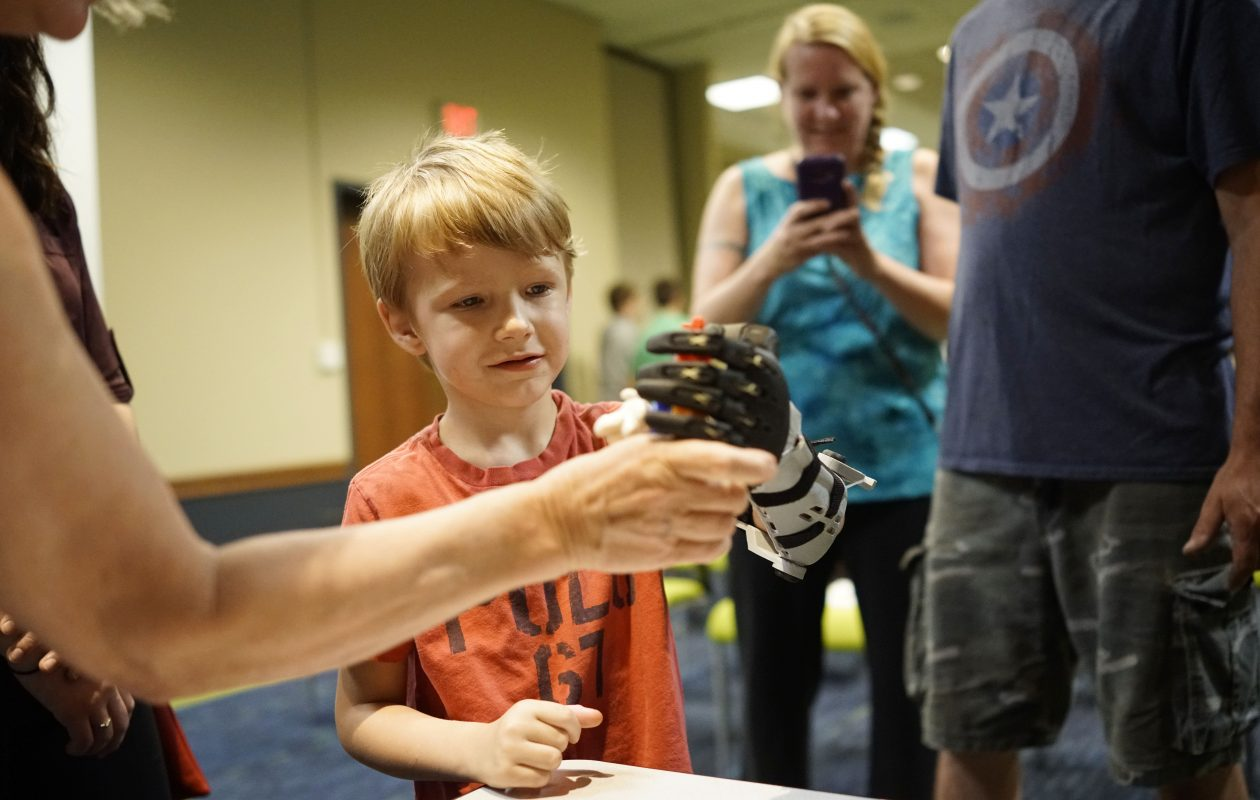 Liam Hilliker, 5, tries out using his new prosthetic arm during the grand finale of the Hand in Hand program at Roswell Park, Tuesday, Aug. 15, 2017.  (Derek Gee/Buffalo News)