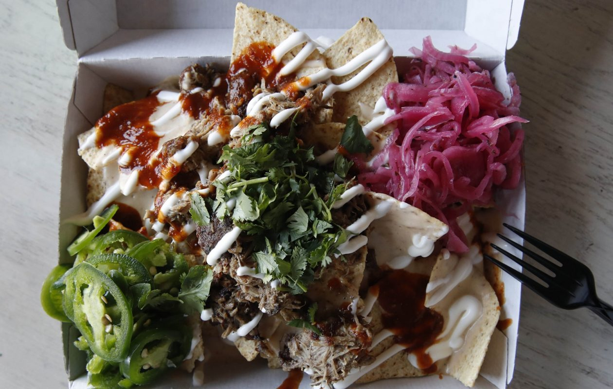 Lloyd Taco Factory's Tricked-Out Nachos are made with corn chips, Lloyd queso, roja, crema, jalapenos and pickled red onions. (Sharon Cantillon/Buffalo News)