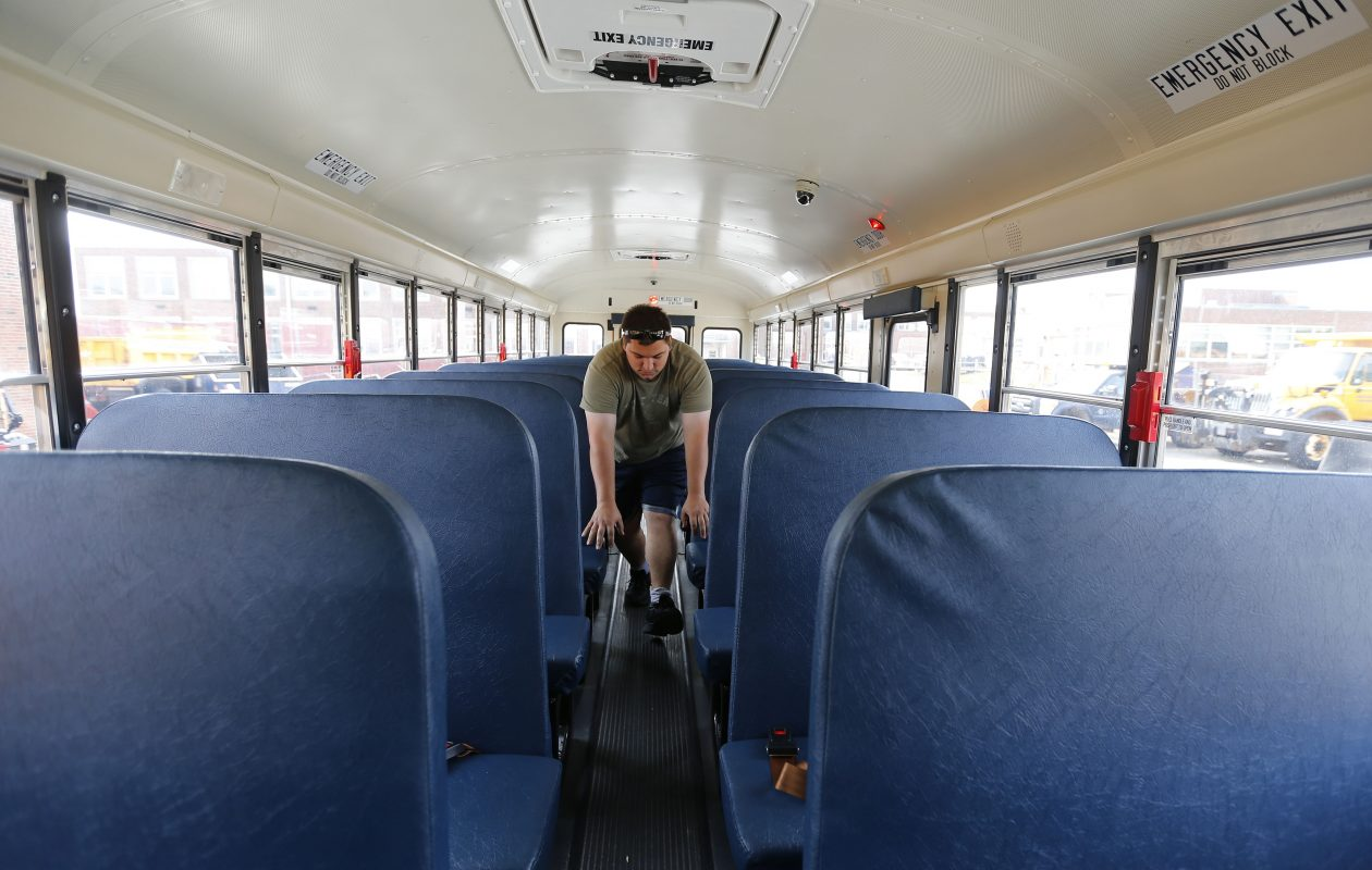 Driver Candidate James Becker inspects the inside of a bus before taking it out on a training ride at the Frontier Central Schools transportation center in Hamburg Monday. (Mark Mulville/Buffalo News)
