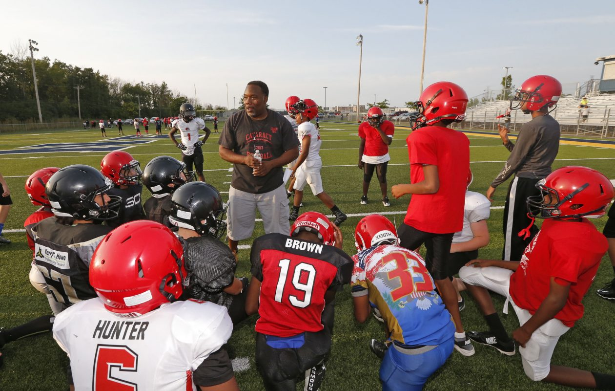Eric Dixon, president of Cataract Little Loop Association, talks with players at practice in Niagara Falls about the positions they will be playing in the season that begins today. Dixon, who came to Western new York to play football at UB from 1992 to 1996, started with Cataract as a volunteer coach in 2006.  (Robert Kirkham/Buffalo News)