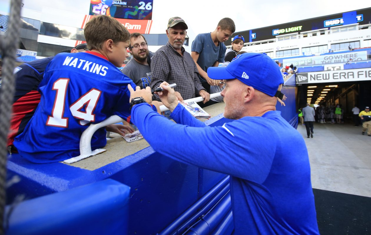 Buffalo Bills coach Sean McDermott signs a young fans Sammy Watkins jersey prior to playing the Detroit Lions at New Era Field on Thursday, Aug. 31, 2017.(Harry Scull Jr./Buffalo News)