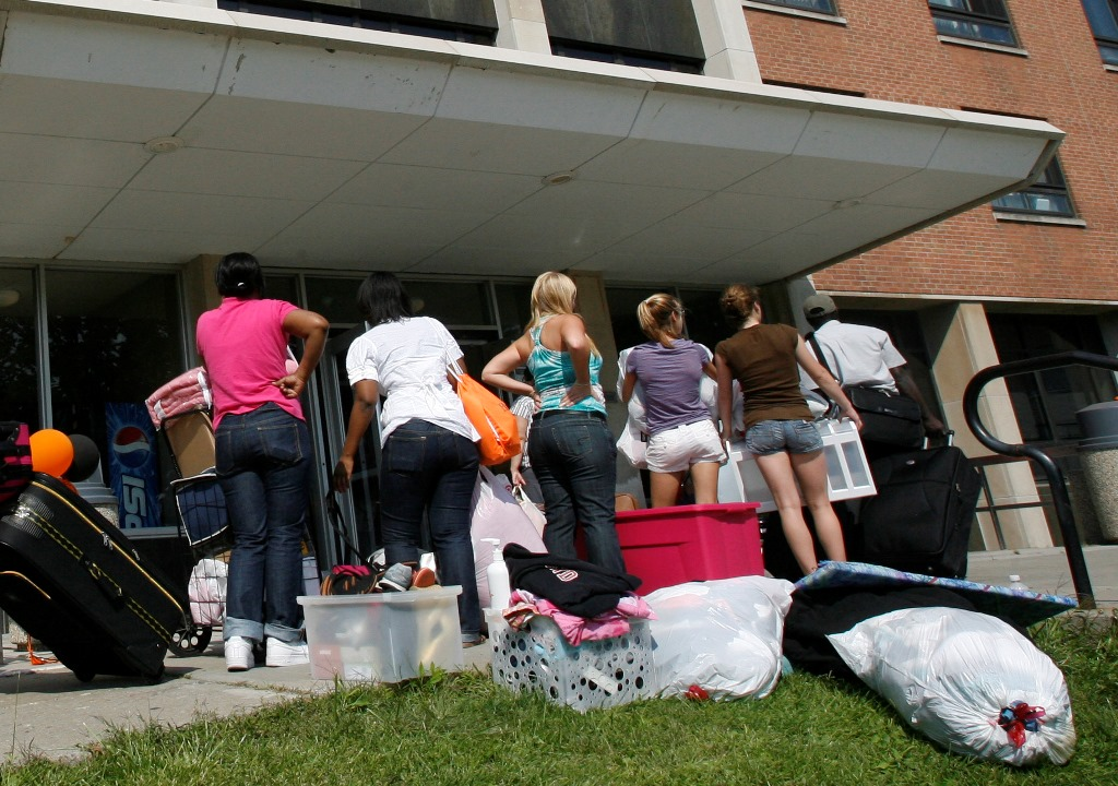 Buffalo State College  freshmen wait in line to move into their dormitory in this file photo. While Say Yes provides tuition, students have to finance other college-related expenses including school supplies, bedding and laundry supplies. (News file photo)