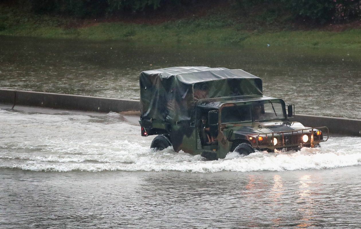 HOUSTON, TX – AUGUST 27:  A military truck navigates along Interstate 10 which has been inundated with flooding from Hurricane Harvey on August 27, 2017 in Houston, Texas. Harvey, which made landfall north of Corpus Christi late Friday evening, is expected to dump upwards to 40 inches of rain in Texas over the next couple of days.  (Photo by Scott Olson/Getty Images)