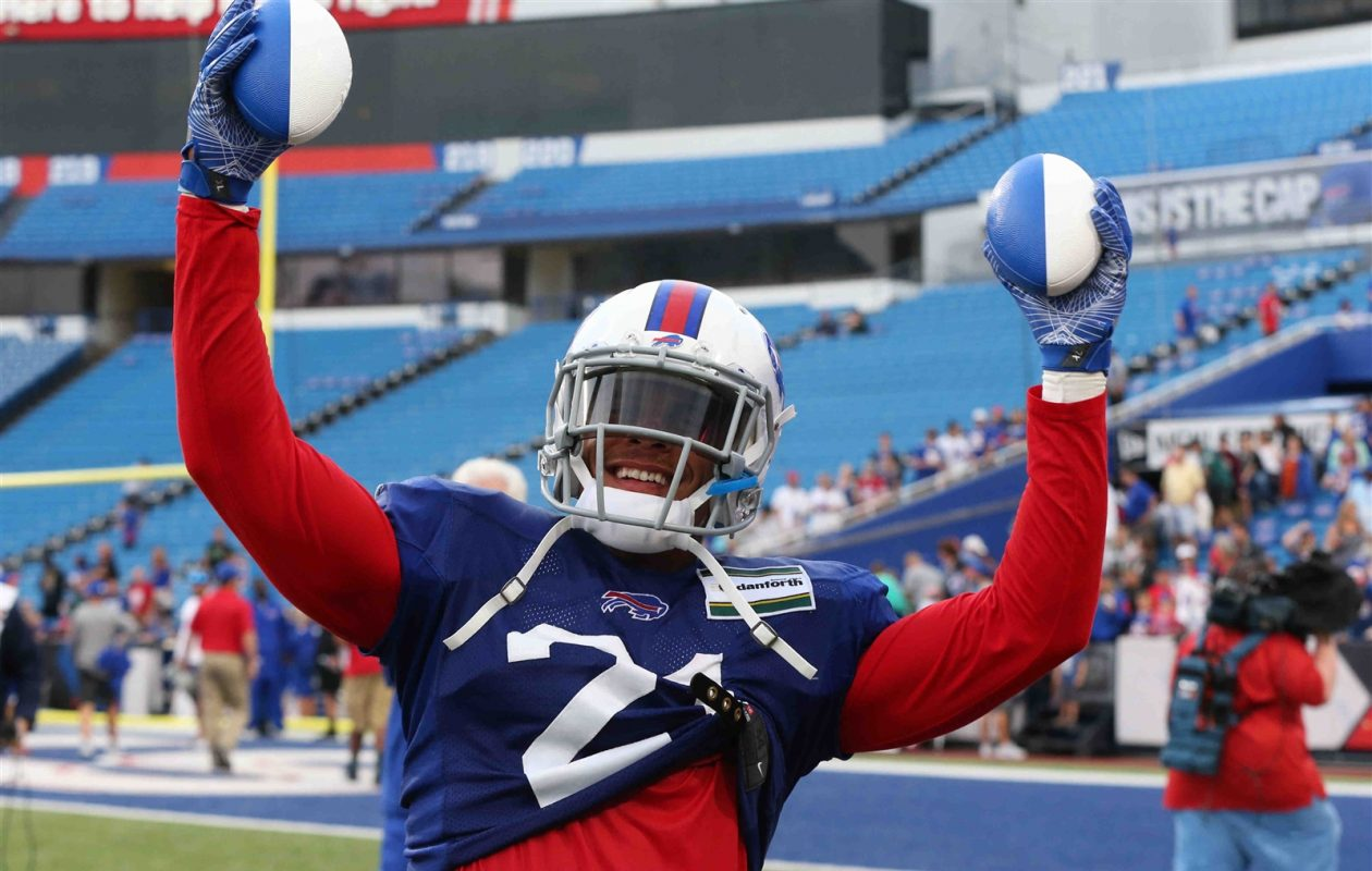 Jordan Poyer has some freebies for fans at Bills practice. (James P. McCoy/Buffalo News)