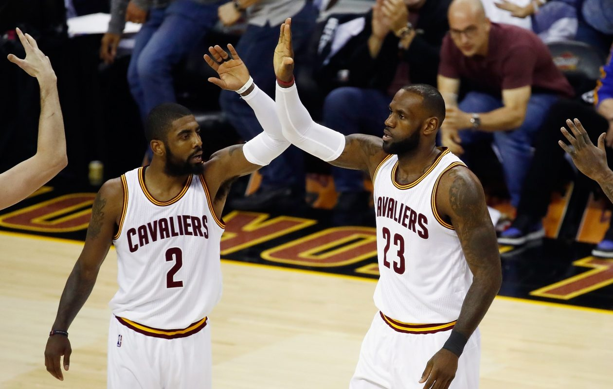Kyrie Irving, left, and LeBron James of the Cleveland Cavaliers celebrate after a play in the first quarter against the Golden State Warriors in Game 4 of the 2017 NBA Finals at Quicken Loans Arena on June 9, 2017, in Cleveland, (Getty Images)