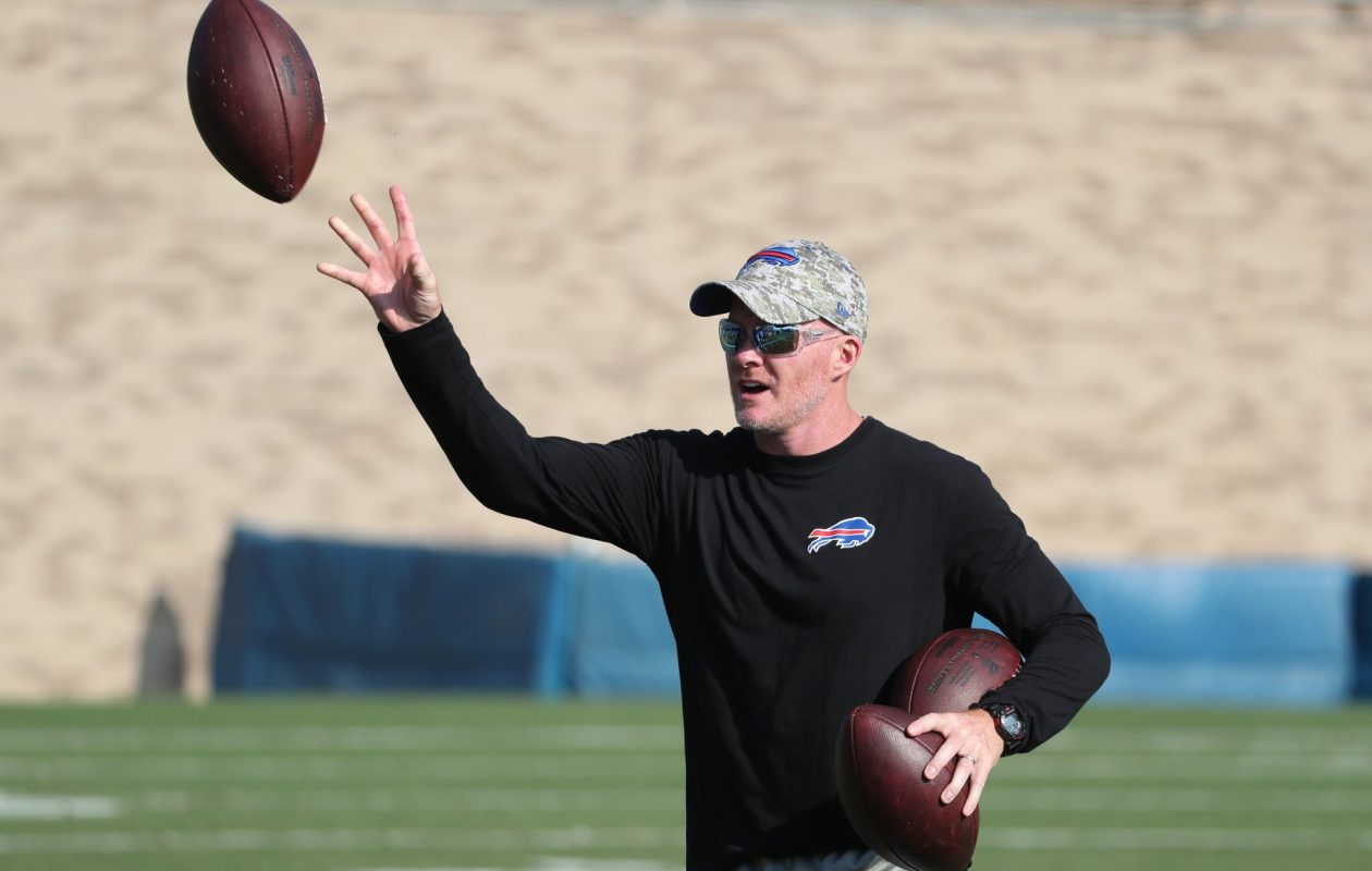 Coach Sean McDermott chipped in and pick up a few of the footballs after a drill during Buffalo Bills training camp Tuesday, Aug. 1, 2017. (James P. McCoy/Buffalo News)
