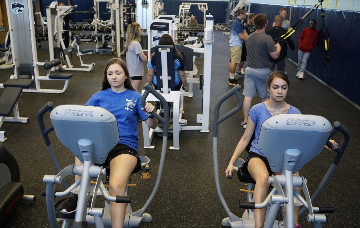 Alexandria Fazio, left, and Elizabeth Maroshick,  both 16, look forward to spending more time in the new Depew High School fitness center after the start of their junior year next week.  (Derek Gee/Buffalo News)
