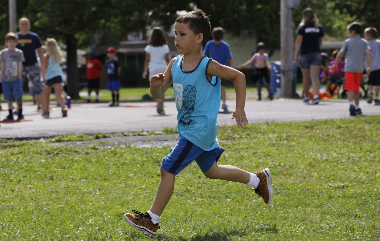 Mason Nagel, 5, demonstrates his running speed during a Depew  Wildcats for Life Summer Camp in Fireman's Park several weeks ago. The Depew school district looks to help students add more physical activity   during the school year,  too. Families, teachers and staff are encouraged to help. (Derek Gee/Buffalo News)