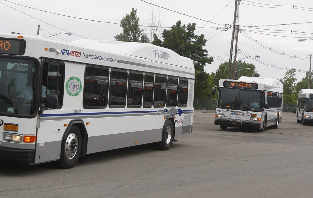 NFTA buses take to the streets in Buffalo in this file photo from June 18, 2012. {Mark Mulville / Buffalo News}