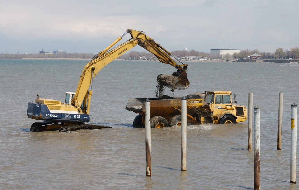 A work crew dredges sand out from the boat launch area at the Town of Hamburg Park. (Buffalo News file photo)