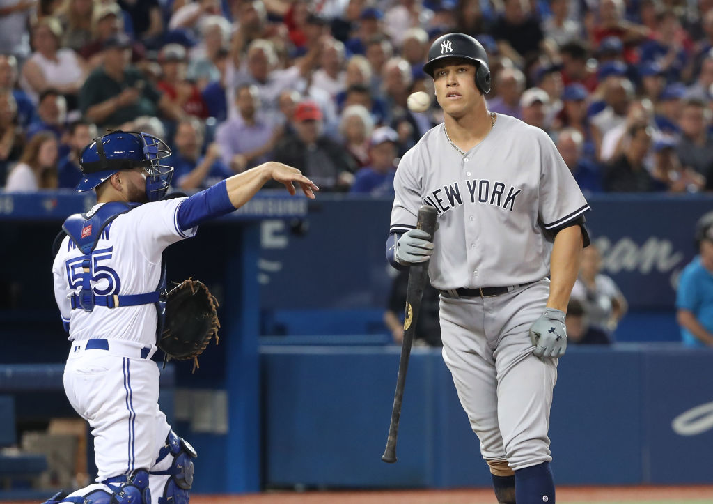 A frustrated Aaron Judge returns to the dugout after striking out Tuesday in Toronto (Getty Images).