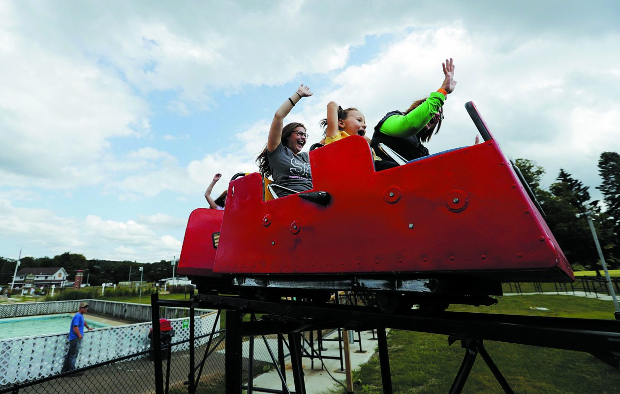From left to right; Erin Manning, Daisy Sheldon, and Jody Sheldon enjoy a ride on the Little Dipper at Midway State Park in Bemus Point Friday, August 25, 2017.            (Mark Mulville/Buffalo News)