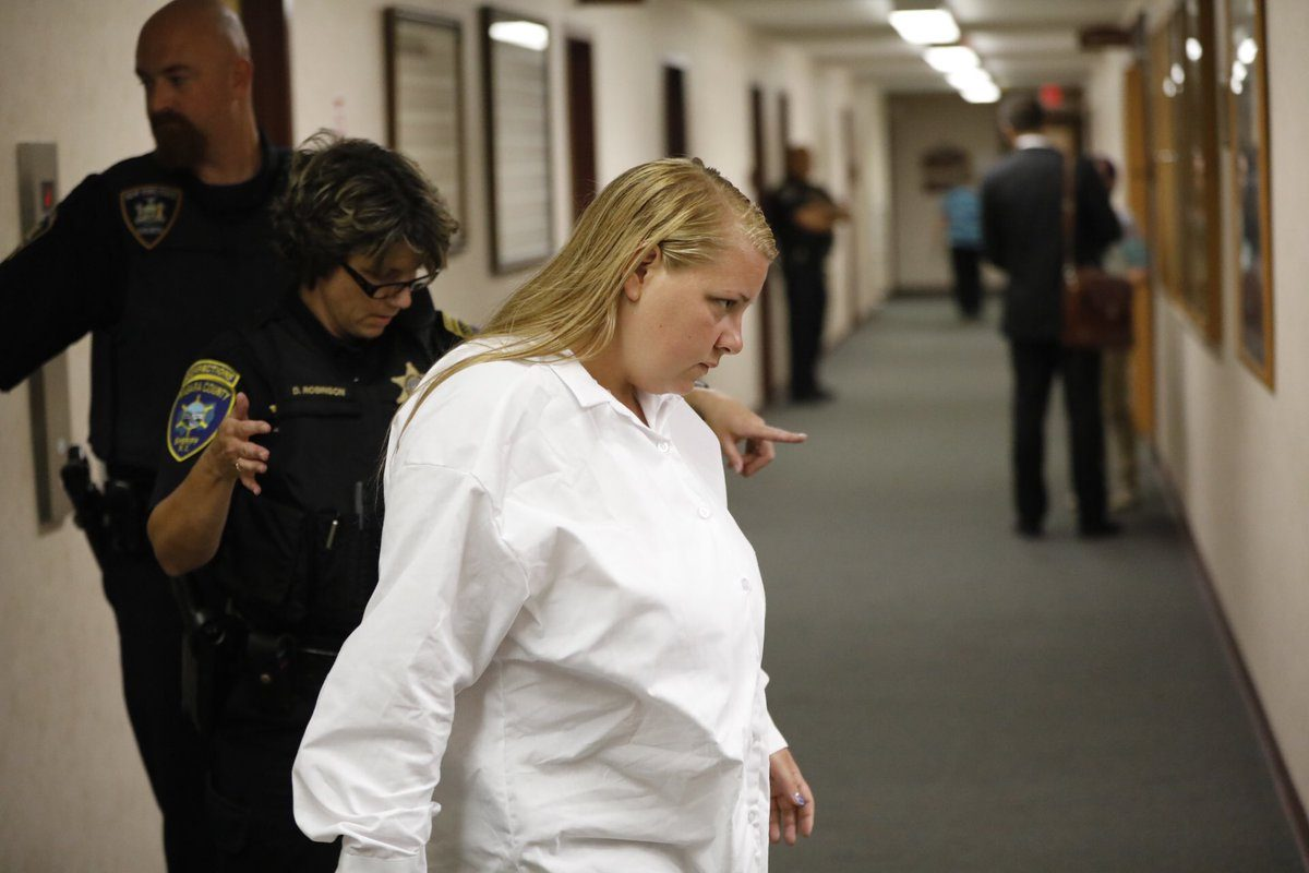 With her manslaughter conviction overturned, Jennifer Marchant is escorted into Niagara County Court where the process for her release began Wednesday. (Derek Gee/ Buffalo News)