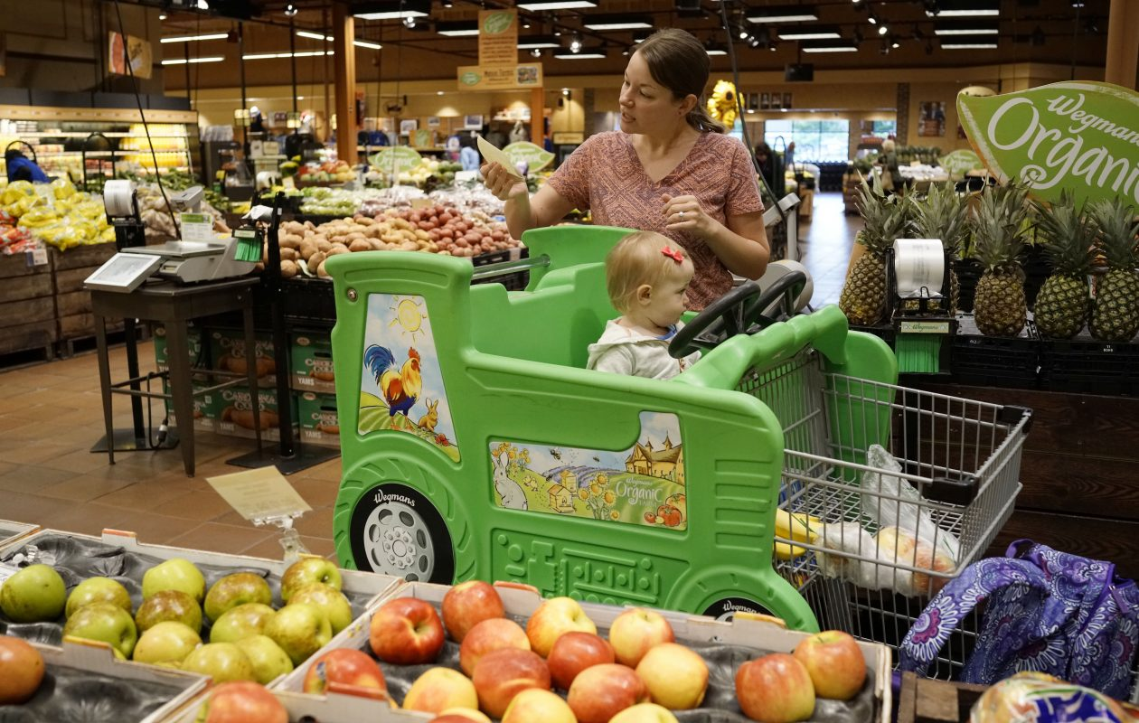Katie Smith shops with her 1-year-old daughter, Brooklynn, at the Wegmans on Alberta Drive in Amherst on Monday, Aug. 14, 2017.(Derek Gee/Buffalo News)