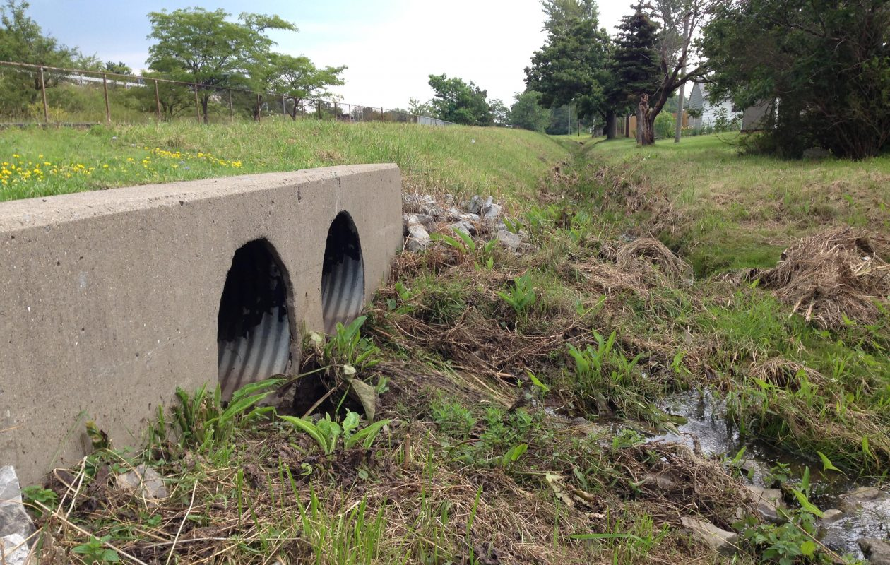 A new concrete 'box culvert' will replace this two-pipe culvert under Winston Avenue in an effort to fix flooding problems in the Winston-Vegola neighborhood of Cheektowaga. (T.J. Pignataro/Buffalo News)