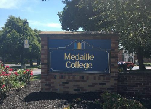 A newly installed sign marks the entrance to Medaille College in Buffalo