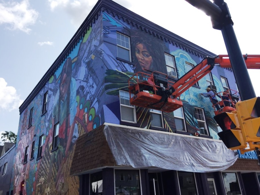 A mural dedicated to Hispanic heritage was unveiled Friday morning on Buffalo's West Side. (Aaron Besecker/Buffalo News)