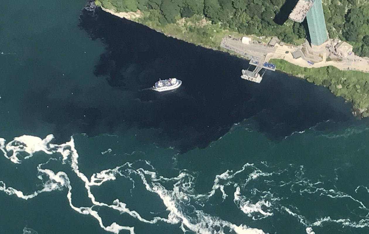The Maid of the Mist floats through a pool of black sludge in late July.