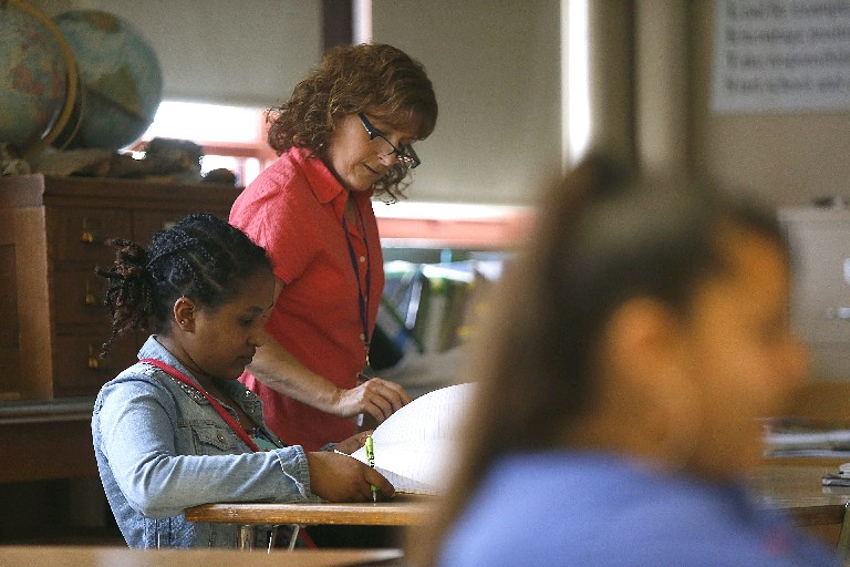 The Buffalo school district and its teachers union disagree over whether the extra 25 minutes added to the school day may be used for teacher planning or should be devoted solely to instruction, like that being given here by Lafayette High School teacher Mary Jo Hellerer. (Robert Kirkham/Buffalo News file photo)