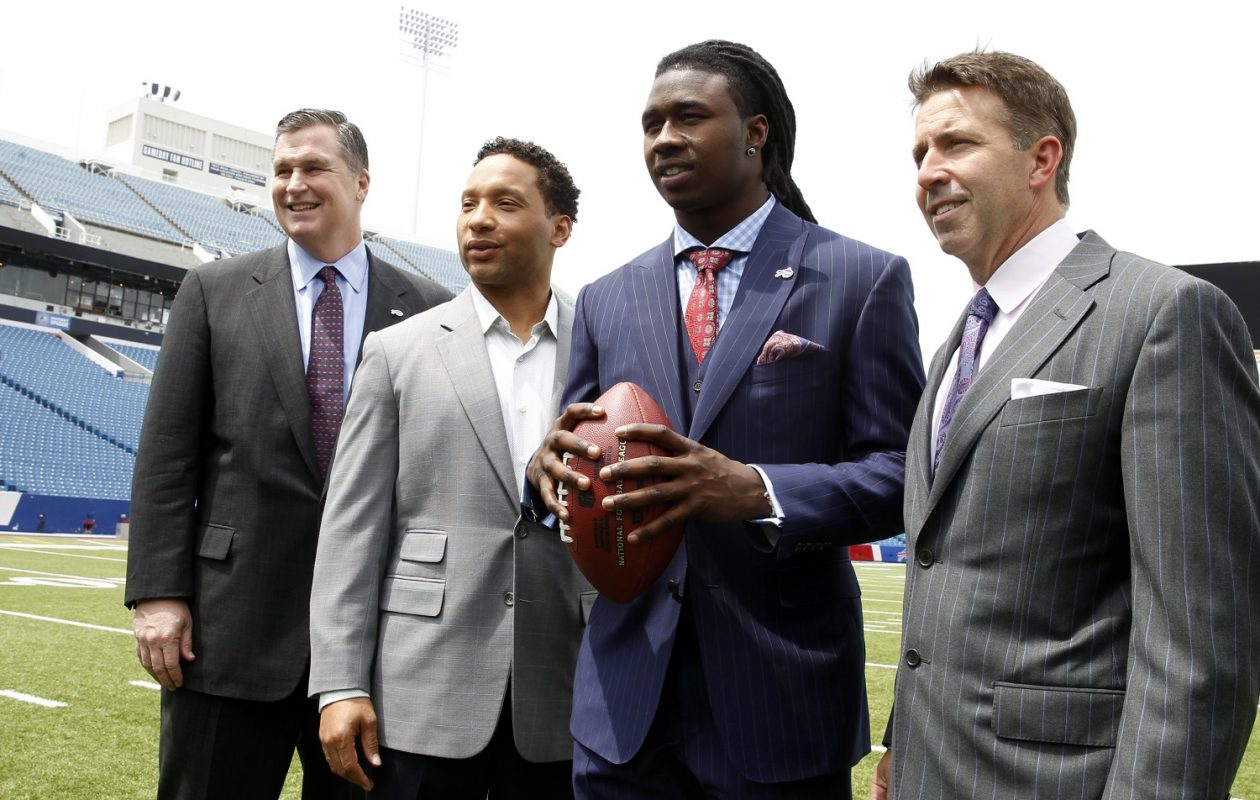 2014: Buffalo Bills coach Doug Marrone, left,  Doug Whaley general manager,  first-round draft pick Clemson receiver Sammy Watkins, and president and chief executive officer Russ Brandon stand on the filed at Ralph Wilson Stadium in Orchard Park, N.Y. on Friday, May 9, 2014.  (John Hickey / Buffalo News)