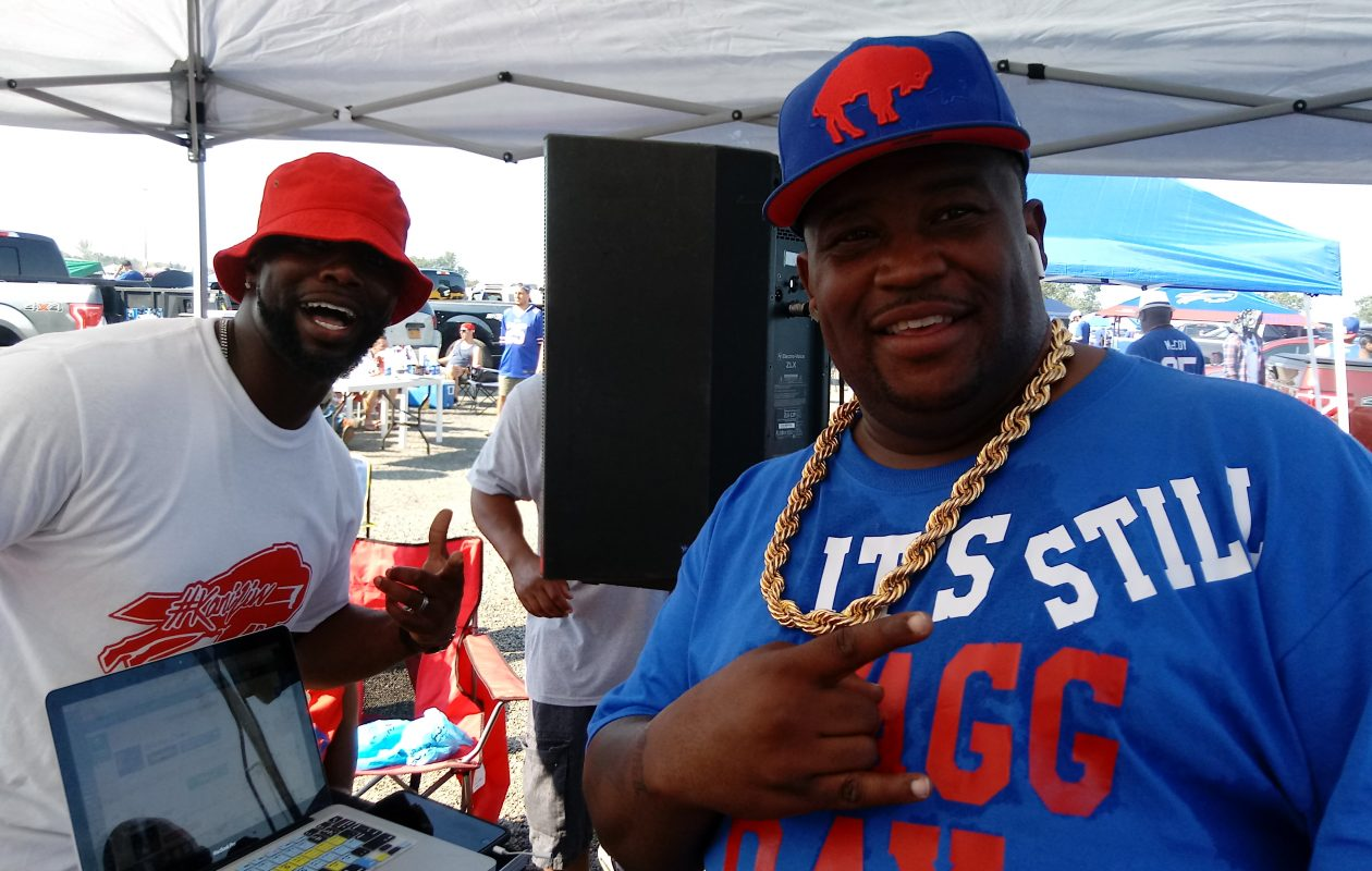 DJ Swagg, real name Doug Wilson (right), of Buffalo, and Kalen Williams, of Lackawanna party on the warmest Bills home game on record Sept. 24. It'll be unseasonably warm again this week at New Era Field, forecasters said. There's a 100 percent chance for sunshine. Temperatures will be in the 70s. (Luke Hammill/Special to The News)