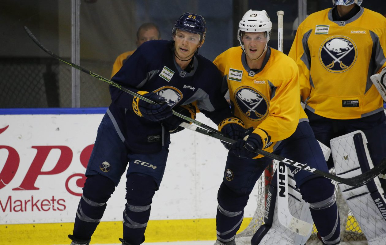Sam Reinhart (23) and Jake McCabe (29) battle for position in front of the net in a scrimmage at Harborcenter during the Sabres' 2016 training camp. (Derek Gee/Buffalo News)