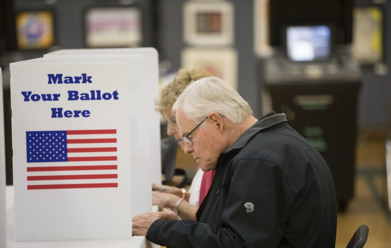 Dean and Nancy Millar fill out their ballots in the Williamsville School District election on May 16, 2017.  (Derek Gee/Buffalo News)