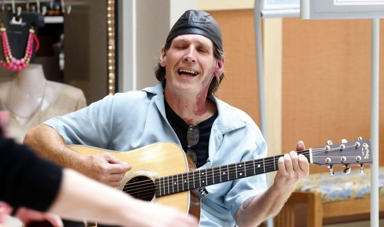 After 14 surgeries, guitarist finds solace playing for other cancer patients