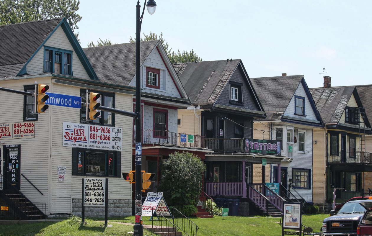 Some of the nine houses that will be demolished to make way for a proposed development by Chason Affinity on Elmwood Avenue at Forest.  (Derek Gee/Buffalo News)